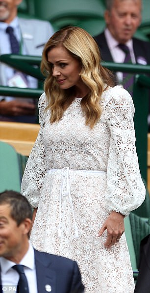 Lovely in lace: Katherine certainly turned heads in her pretty trumpet sleeve dress, which featured a nipped-in waist