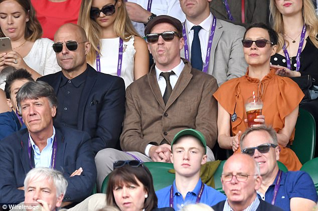Enjoying the view? Damian Lewis was seen absorbing all the action as his wife of 10 years Helen McRory quenched her thirst with a Pimms