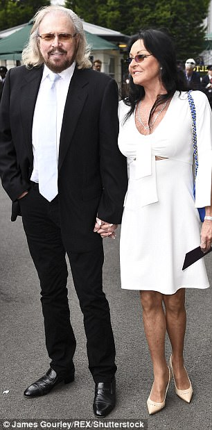 His 'n hers: Former BeeGees star Barry Gibb and his wife Linda stepped out in complementing ensembles as they made their way to their seats