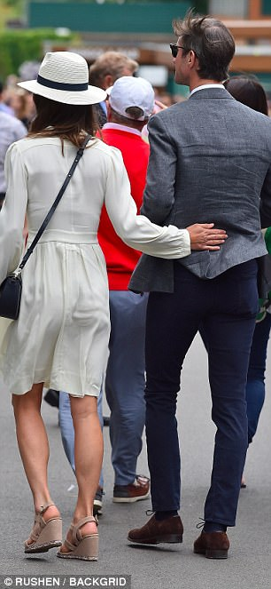 Sweet: Clearly still in the throes of wedding bliss, the newlyweds appeared smitten with each other as they strolled through the grounds arm-in-arm