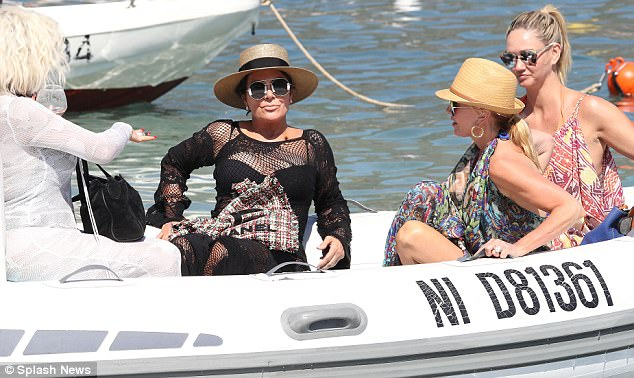 Work it out: The star looked impossibly chic as she reclined on the boat ahead of a day of relaxation