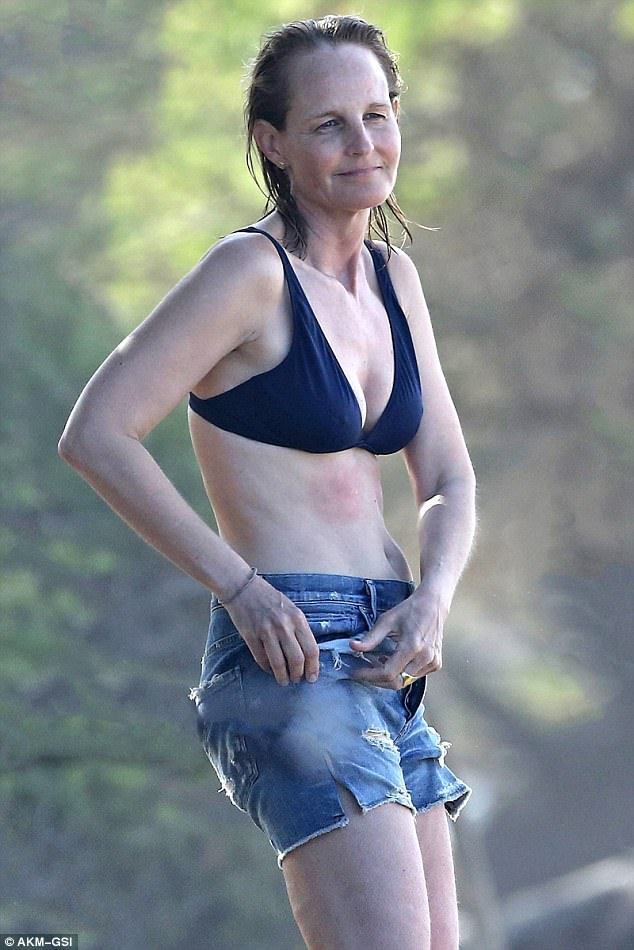 Shorted! Helen continued to reveal her slim body, throwing on a pair of flattering cut off shorts after drying off from her surf