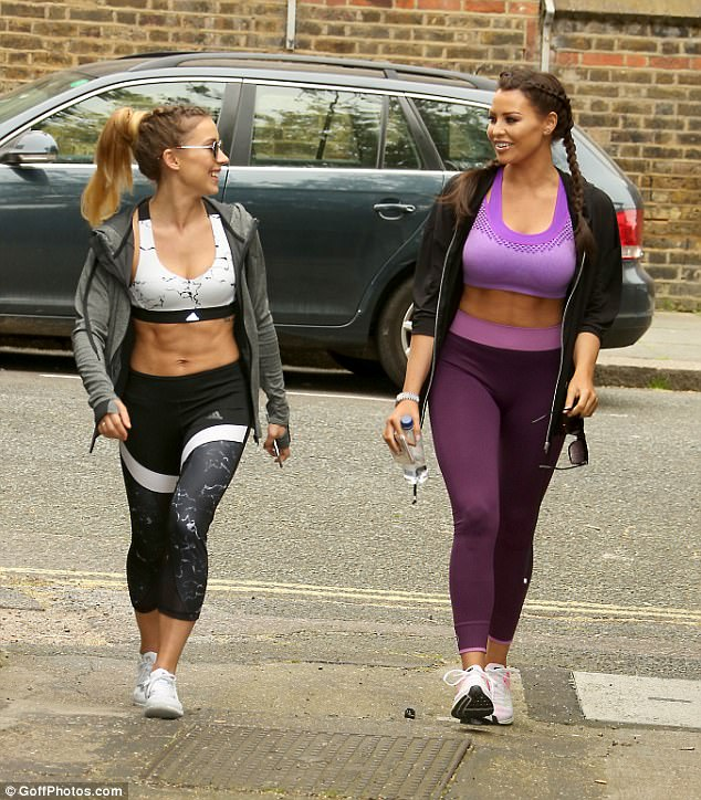 Let's do this: Jess appeared in good spirits as she laughed with her equally-ripped trainer Esmee on their way to the gym