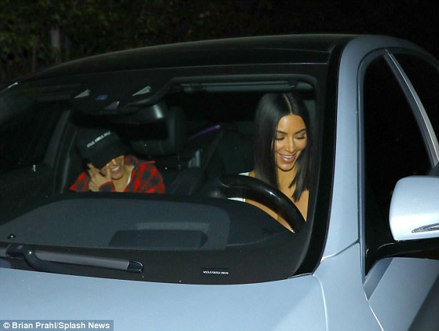 Kim's at the wheel: The brunette was in charge as she and her pal went off for the night