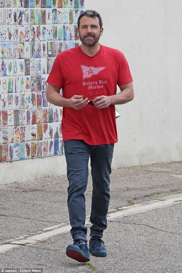 He sure seems jolly: Ben joined his family for church service as he wore a Baker's Bay Marina red T-shirt