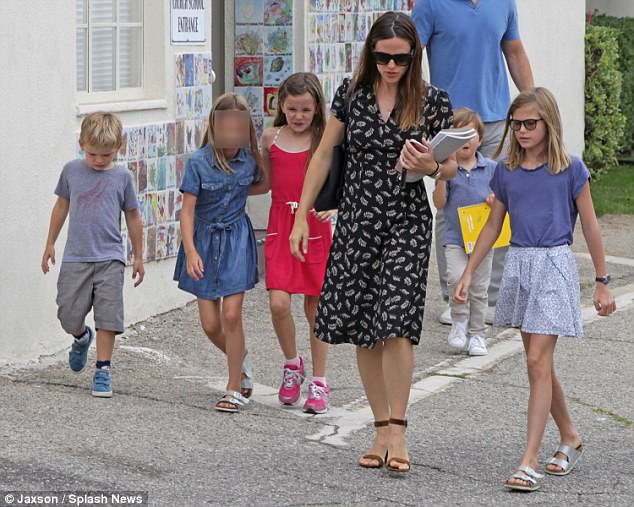 With her little ones: Jennifer Garner and Violet, 11, Seraphina, eight, and Samuel, five, at church on Sunday