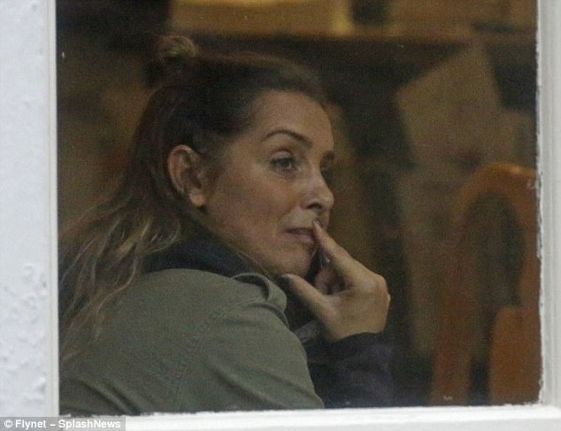Pensive:The star - who admitted that she is living apart from her husband - appeared sombre as she strolled around the town after being seen earlier in the day taking a fraught phone call