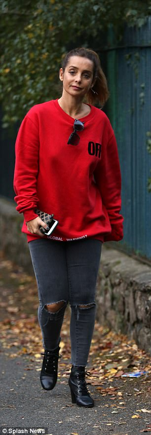 Downcast:The former Strictly Come Dancing contestant, 42, looked sombre as she stepped out in an oversized red jumper, emblazoned with the words 'off'