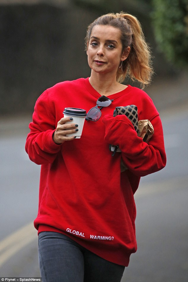 Caffeine hit: Louise clutched a coffee to perk herself up between gruelling rehearsals