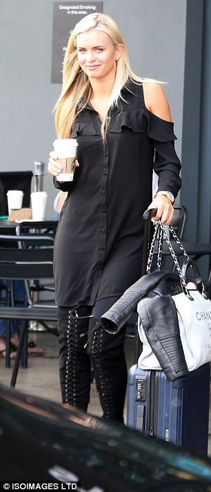 She's got style:Nadiya Bychkova oozed sex appeal in her cold shoulder button-down dress, toting her luggage as she headed to the show