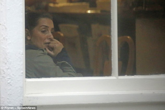 Bad call? Louise Redknapp appears emotional as she takes a fraught phone call while alone in a cafe... amid marital troubles with husband Jamie