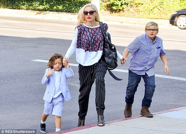 She's a success: Gwen (pictured with Zuma and Apollo) has juggled her high-flying singing career with being a doting mum to her three children