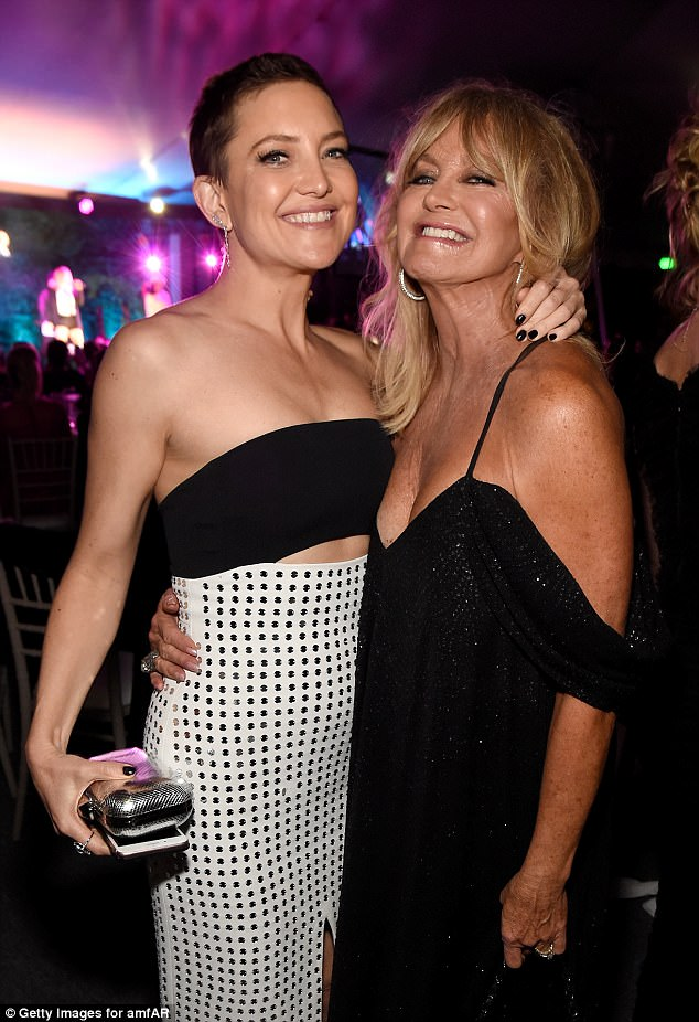Mother like daughter: Kate Hudson cosied up to her mother at the bash