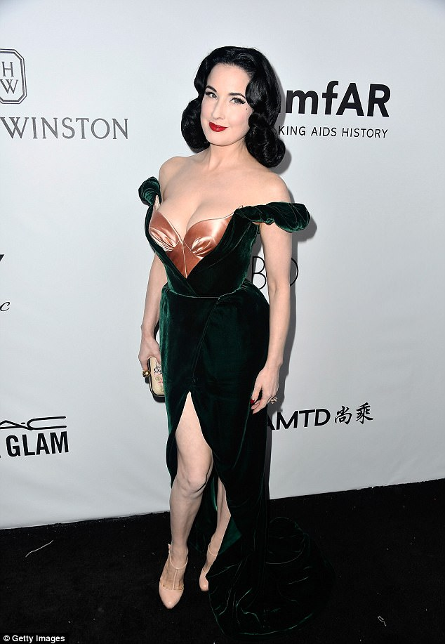 Raven haired beauty:Dita looked incredible in the sizzling gown which made the most of her eye-popping curves - made famous by her career as a dancer