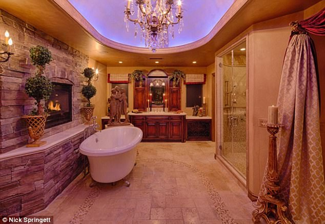Why ever leave? Even the master bathroom is wildly opulent, as one can enjoy a crackling fire while bathing in either a claw foot tub or massive double door shower