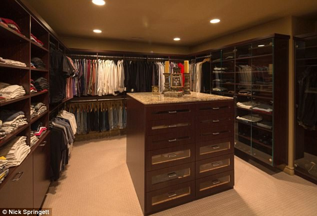 Spoiled for choice: A massive walk-in closet with glass display cases ensures any occupant will be well outfitted
