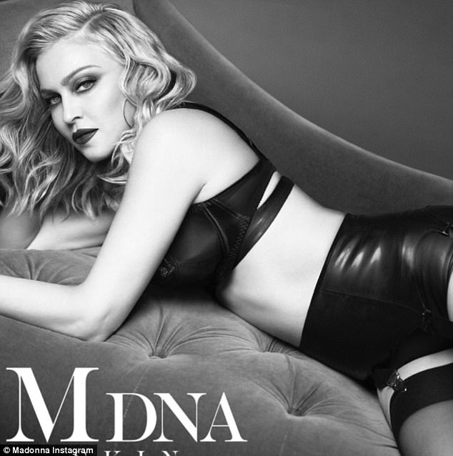 Still got it: Madonna shared a series of raunchy shots on Instagram to promote her new skincare line on Friday