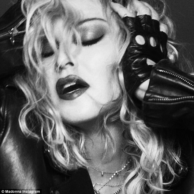 Migraine: 'If Friday is giving you a headache... massage temples with leather gloves!' she joked of one close-up shot of her doing just that