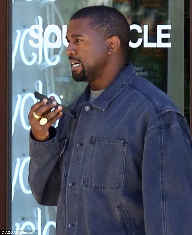 Spinning: Kanye was seen walking out of the stationary bike studio talking on the phone, while dressed in a denim on denim ensemble