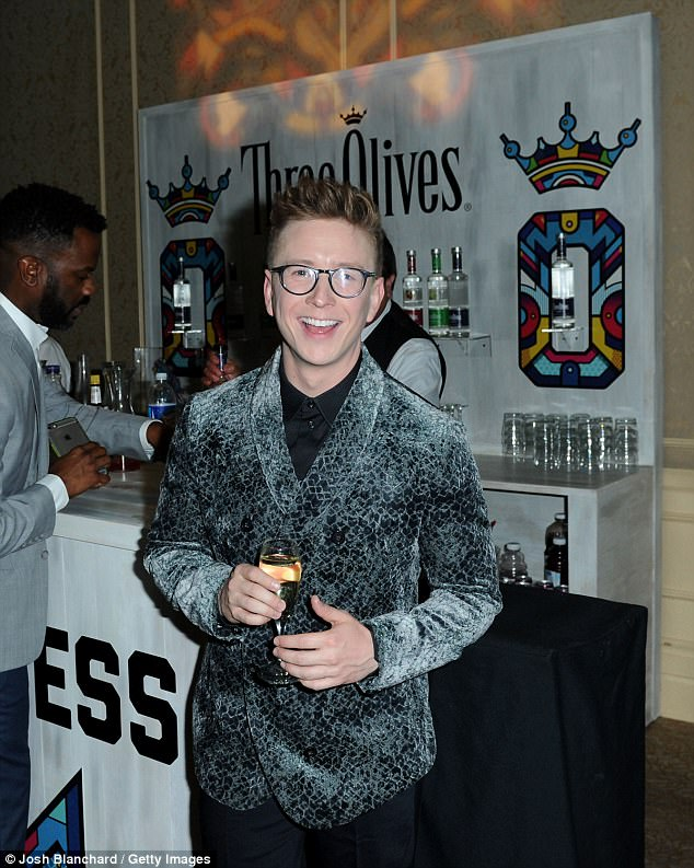 Tyler Oakley toasts with Three Olives Vodka in support of The Trevor Project at TrevorLIVE Gala