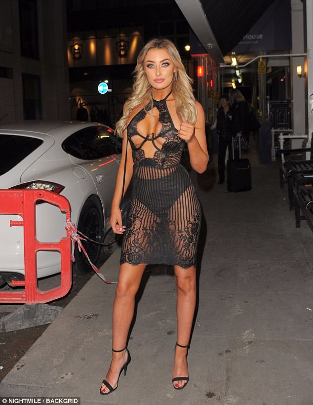 Eye-popping: Chloe ensured all eyes were on her as she teamed her daring number with barely-there heels