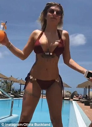 Shake it!Clad in a skimpy burgundy bikini, the beauty's enviably slender figure and incredibly tiny waist came into full view as she playfully shimmied for the camera