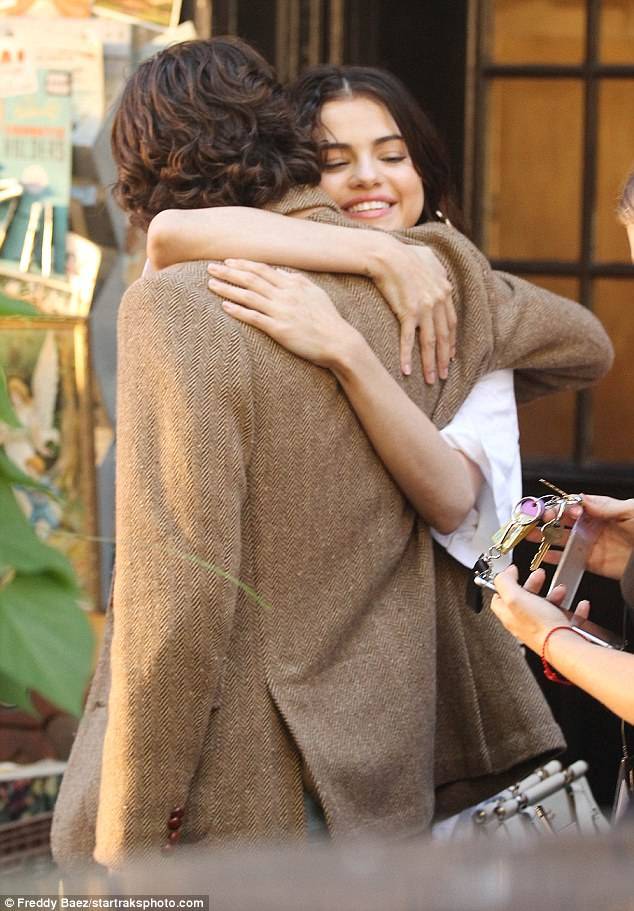 Warm embrace: Selena Gomez gave co-star Timothee Chalamet a big hug on the set of their Woody Allen film on Friday
