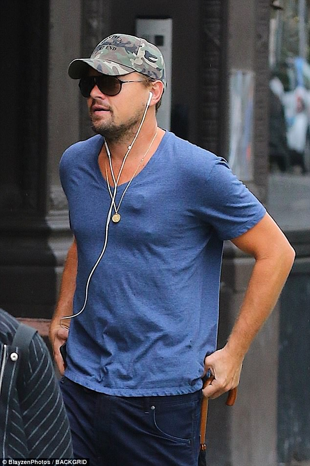 Single man: Leonardo DiCaprio was spotted wearing a circular device on his chest while out in New York City on Friday