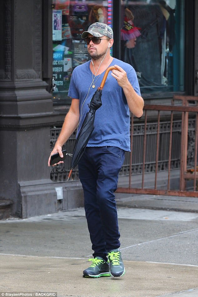 Tuned out: The 42-year-old actor was spotted with his ear buds in while out for a stroll the day before
