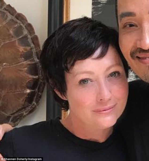 Looking good! Shannen Doherty debuted her 'sexy Parisian' pixie hairdo, which is her first cut/styling since shaving it all off a year ago while battling breast and lymphatic cancer