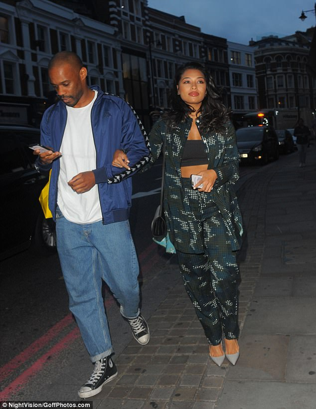 Heading off: She was spotted leaving the venue on the arm of a male pal, calling it a night after a fun-filled evening