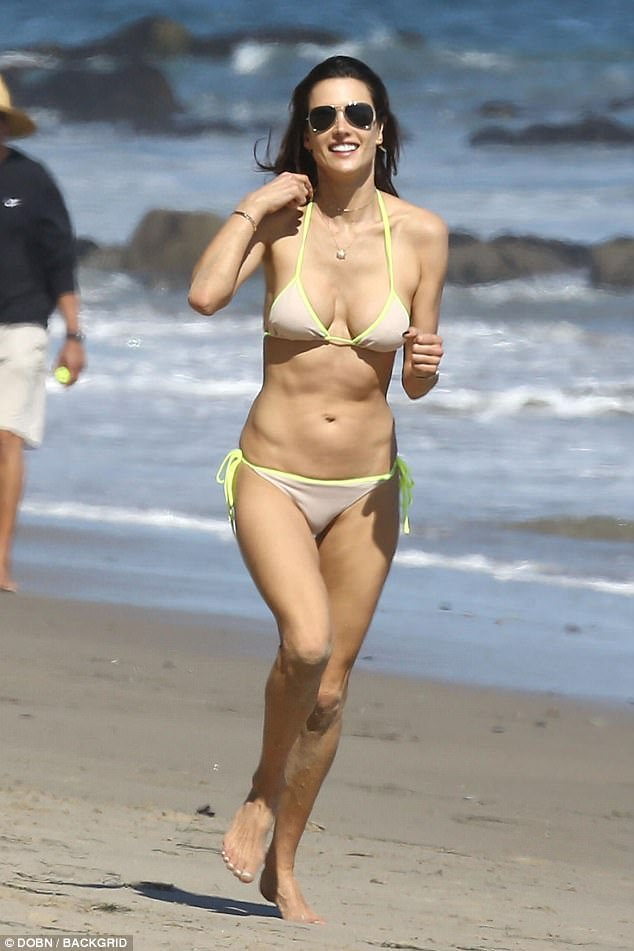 Beach babe: Alessandra Ambrosio, 36, flaunted the fruits of her labour as she put on a sizzling display while frolicking on the beach in Malibu, California on Tuesday