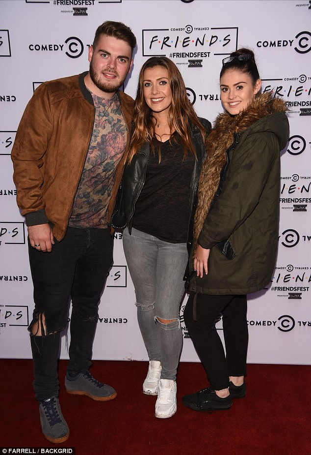 Stunner: Kym Marsh looked every inch the doting mother as she proudly posed alongside her eldest children David Ryan Cunliffe, 22 and Emilie Mae Cunliffe, 18 at the star-studded Friends Fest event in Manchester on Tuesday night