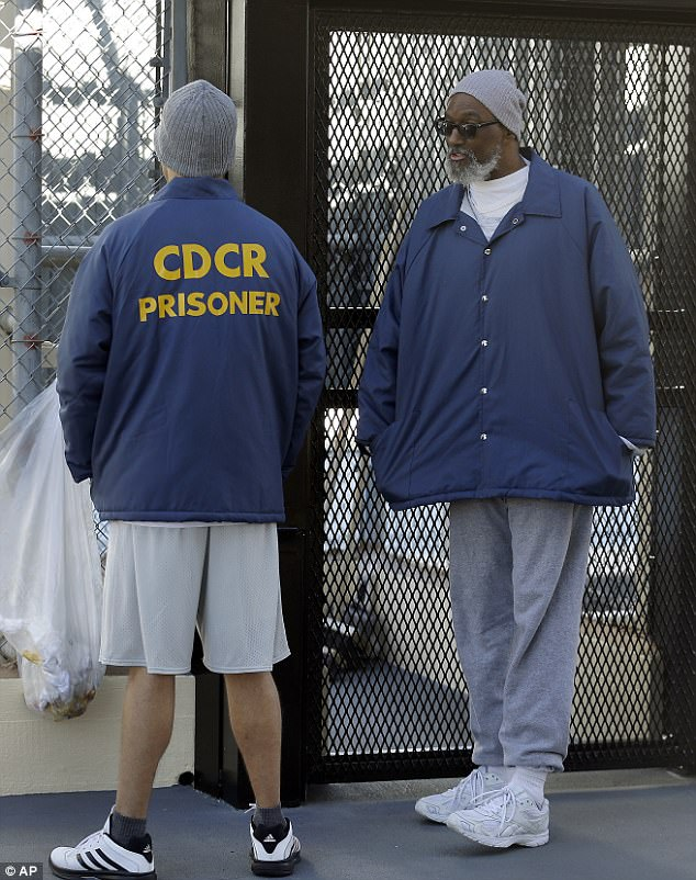 This is the most recent photograph of Peterson. He is shown to the left, talking with another inmate, inside San Quentin in December 2015