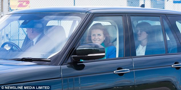 Sarah Ferguson, known as Fergie, smiled for the cameras after the family's plane landed in Aberdeen