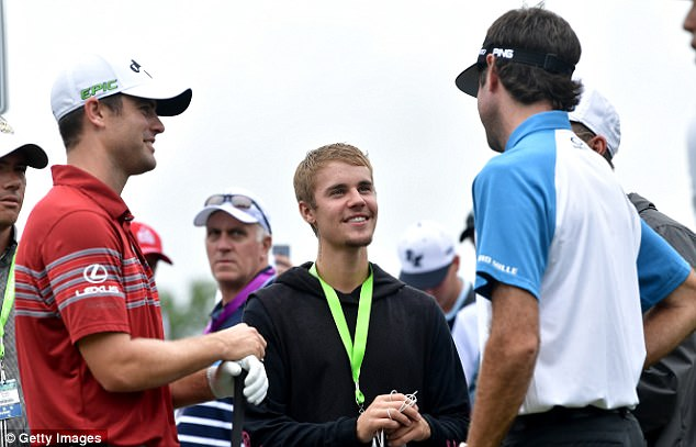 They're the stars this weekend: Justin looked star struck as he talked to pros Wesley Bryan and Bubb Watson before the PGA Championships