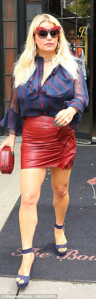 On the go: The 37-year-old star teamed a tight red skirt with a billowy blouse as she headed out solo from The Bowery Hotel