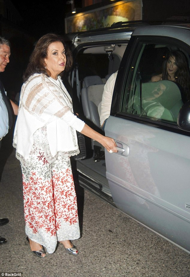 Good genes: Baria (above) proved style runs in their family in chic floral trousers and a lace blouse