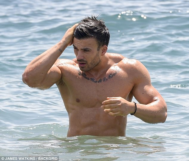 Looking good:Revealing sharply defined abs, pectorals and biceps, Mike's increasingly bulky upper-body suggested he has been no stranger to the gym over recent months