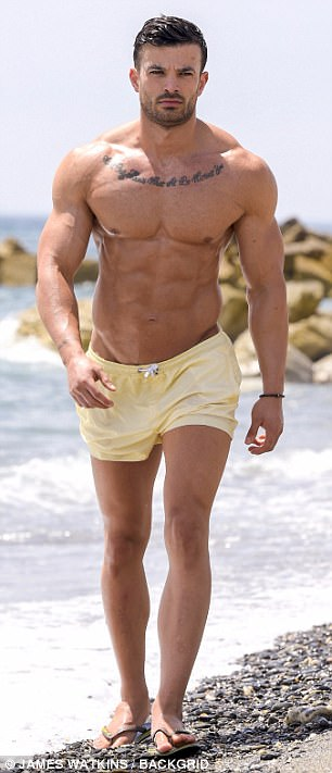 Here he comes: Mike was hard to miss as he made his way back onto the beach in a pair of lemon yellow shorts