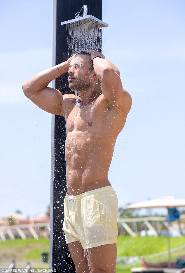 That's better:Cooling off beneath an outdoor shower, Mike was seen rinsing salt water out of the hair he opted to thicken with a lengthy procedure at Kent based KSL Hair in November