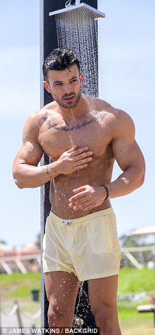 Busy boy: Mike is in the Spanish coastal resort town to film scenes for the forthcoming series of TOWIE