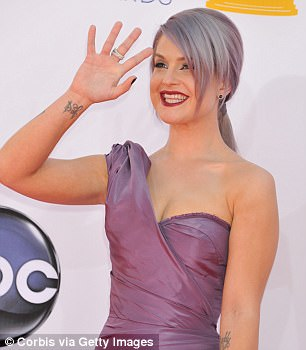 Nail bling: Kelly Osbourne, 32, wore black diamond nail polish from Azature worth $250,000 at the 2012 Emmy Awards