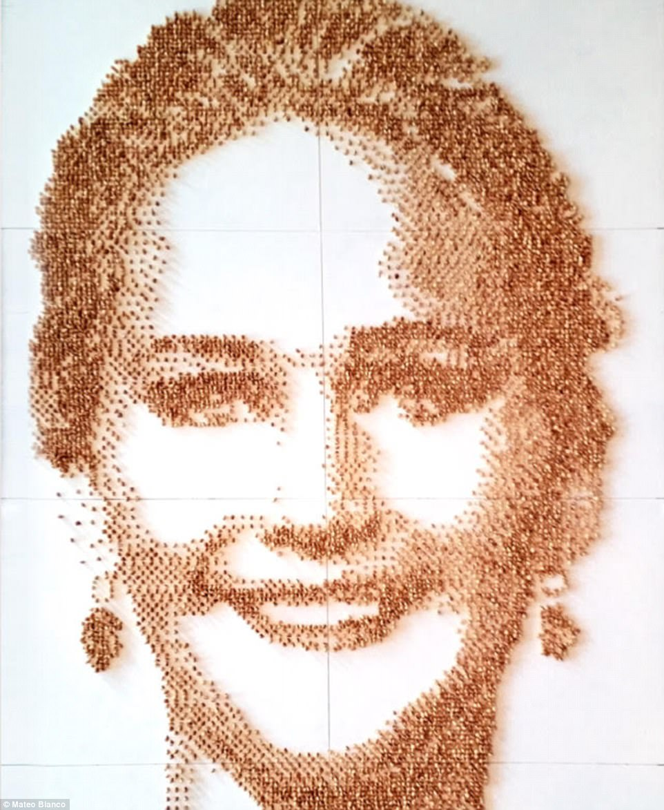 J-Law like you've never seen her: This image of Oscar-winning actress Jennifer Lawrence is made out of nearly 10,000 peanuts and was the most photographed work of art the summer of 2016