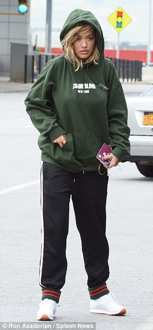 Relaxed: The singer added to her low key look with a pair of simple white running shoes