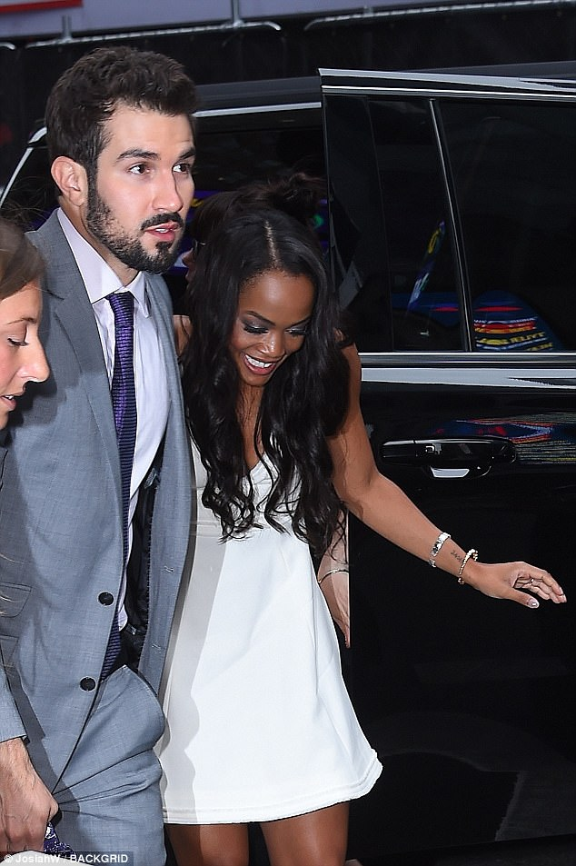 Smile! Lindsay looked a natural in front of cameras as she stepped out of her car, hand-in-hand with her beau