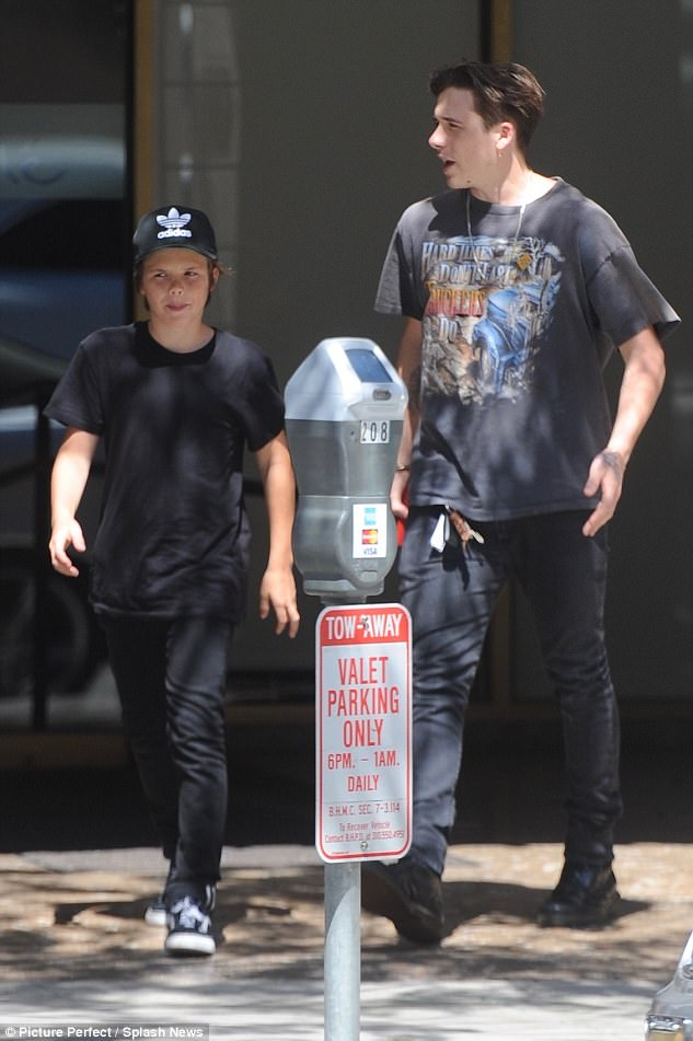 Brotherly love: The siblings were not joined by mum Victoria or brother Brooklyn for the game. But the eldest child of the Beckham clan was enjoying some quality family time on Monday as he took Cruz out to grab some sushi in Beverly Hills