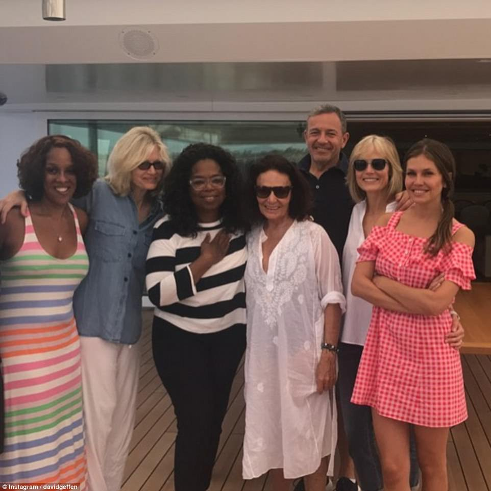 A smiley-looking Dasha (pictured, far right) spent last week without her husband on US businessman David Geffen's yacht Rising Sun,  with guests including Oprah, Diane Von Furstenberg and Disney boss Bob Iger