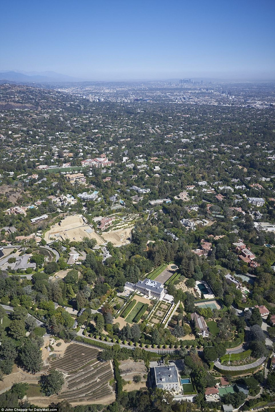 The enormous property also boasts impressive views of  downtown Los Angeles over the treetops at the edge of the estate