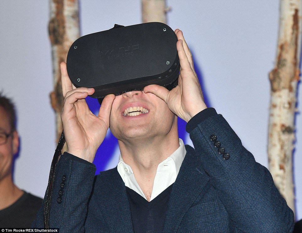 The father-of-two was in his element as he tested out a virtual reality head set during his tour of the event